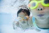 Girls swimming under water