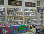 Shop: Comic Books, Wall Art, and Pins.