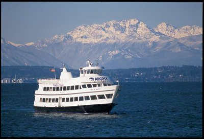Spirit of Seattle Argosy Cruise Ship with mountains in the background