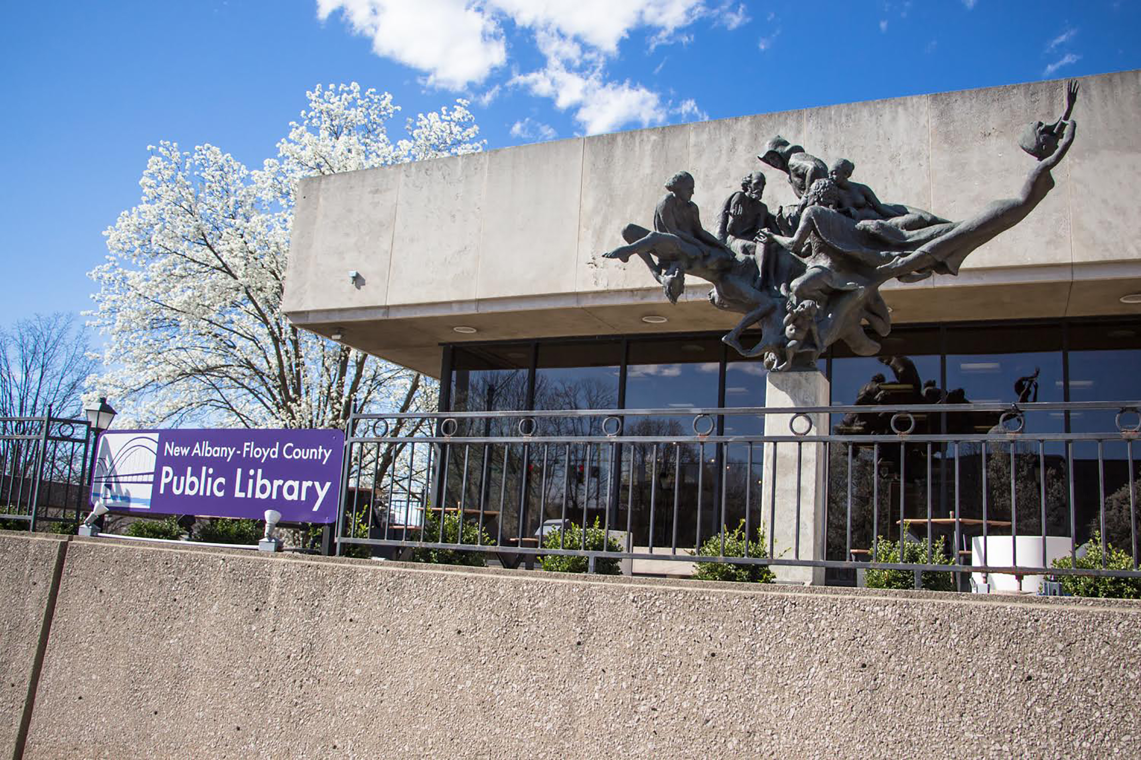 A statue is erected in front of the Floyd County Library