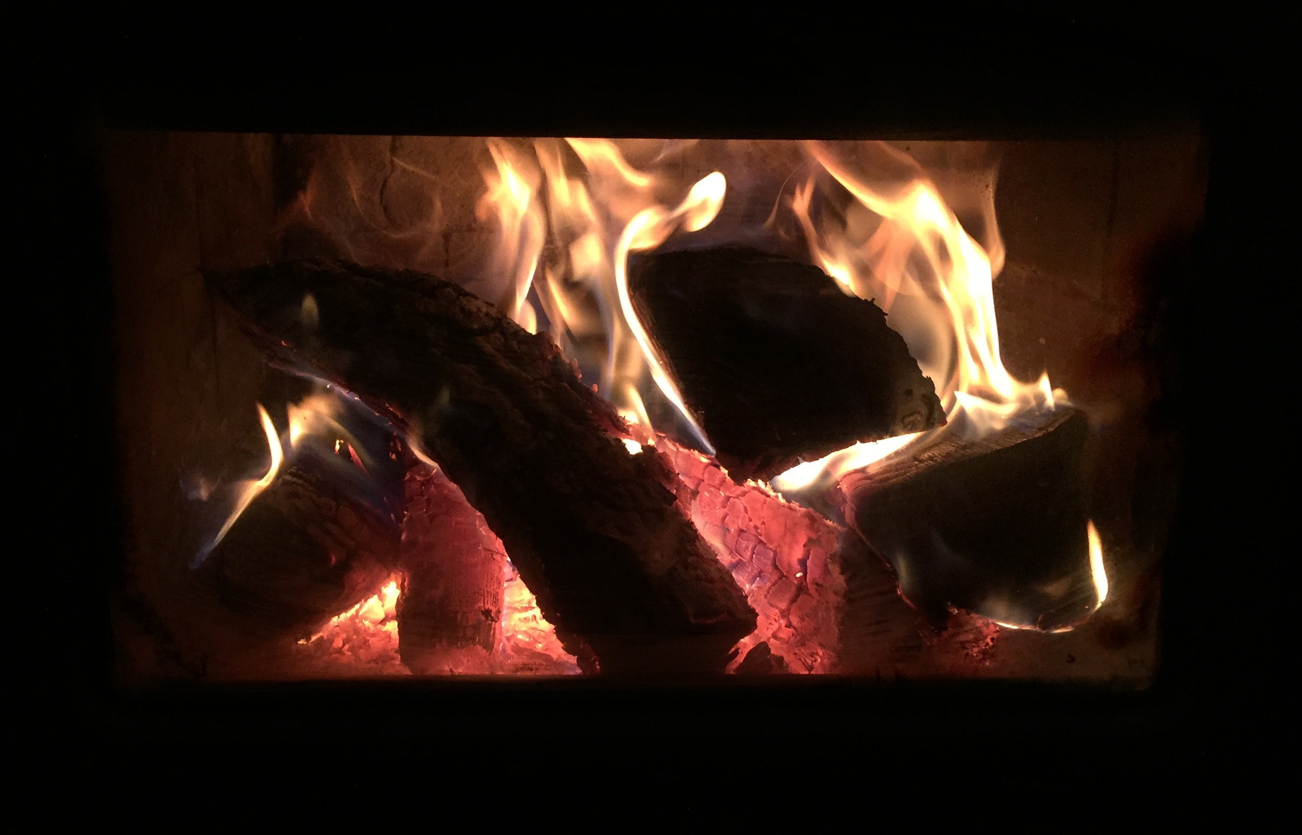 Fireplace roaring at Falcon Trails Resort