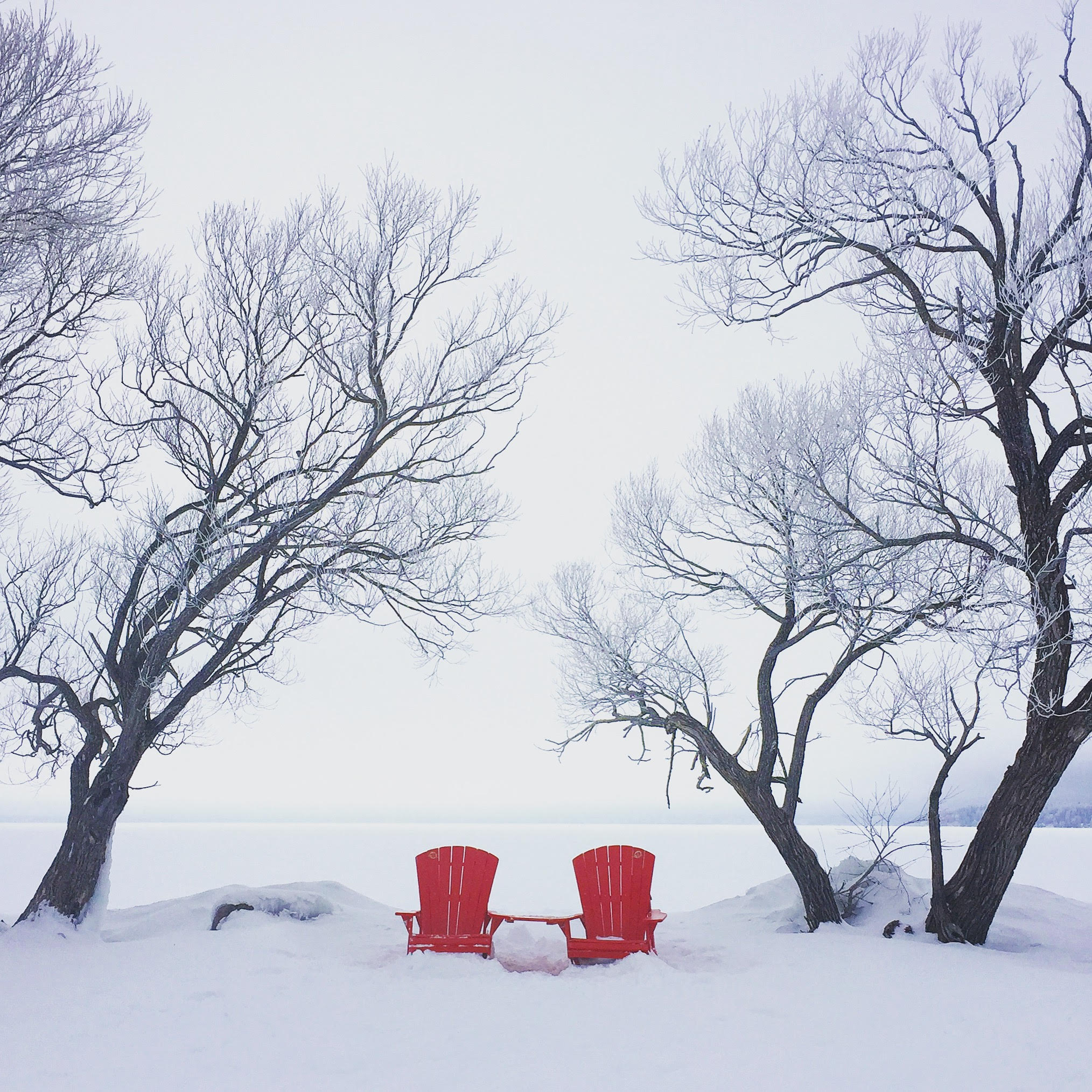 Red chairs overlooking Clear Lake in Riding Mountain National Park