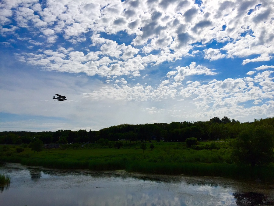 Floatplane flying over Oxbow Trail in Minnedosa