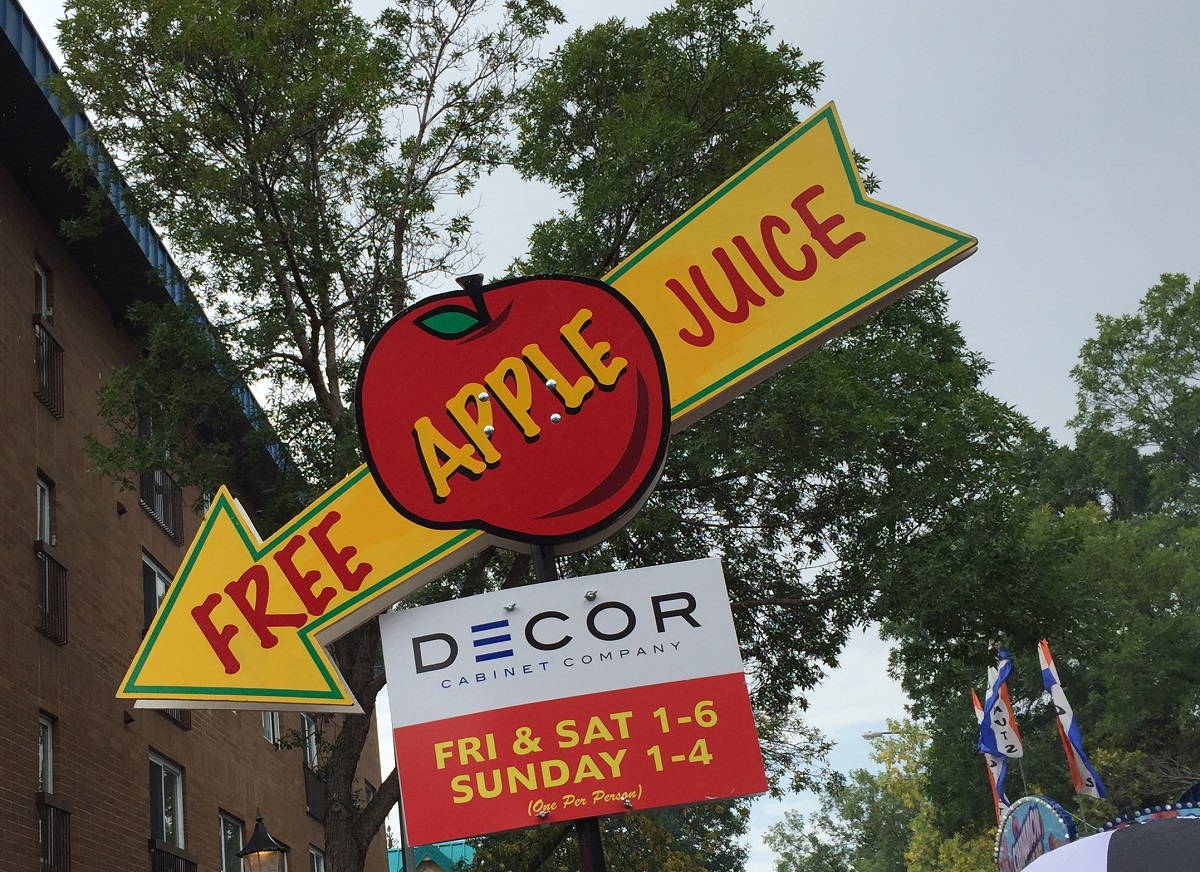 Free apple juice at Morden Corn & Apple Festival, Manitoba