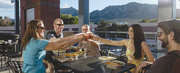 Group of people dining on a Boulder Restaurant patio