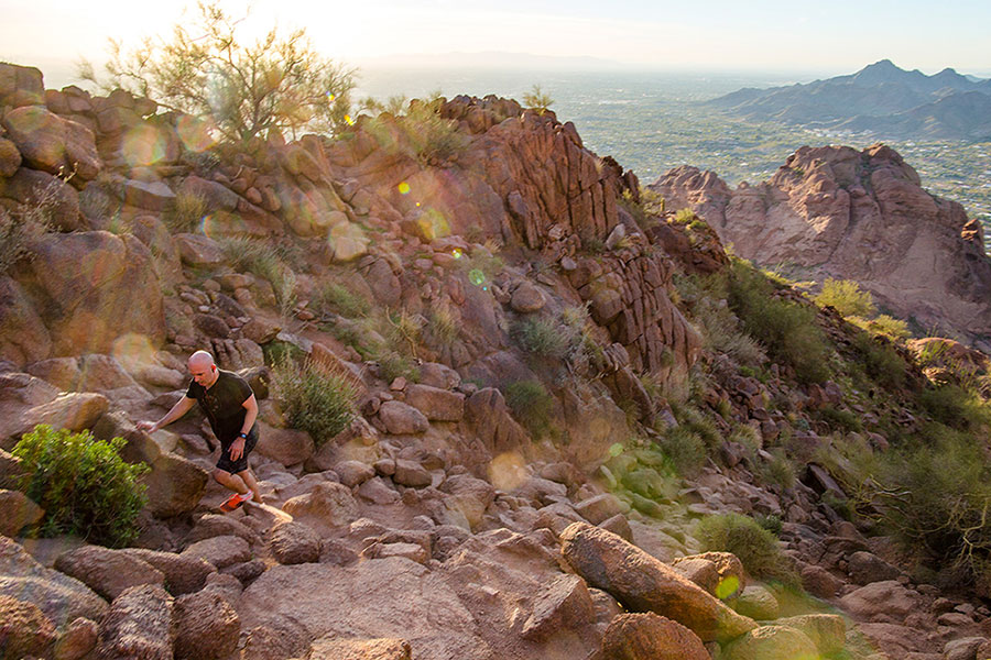 A hiker ascends Echo Canyon trail on Camelback Mountain in Phoenix, AZ