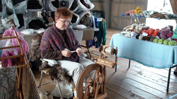 This woman is using a spinning wheel.