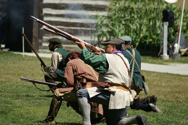Costumed interpreters skirmish at the Fort