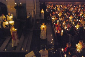 The St. Lucia processional at Trinity English Lutheran is beautifully illuminated by candlelight.