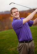 David Lee poses after a swing during a game of golf