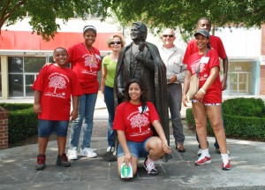 Task: take a picture with a strager at the James Brown statue