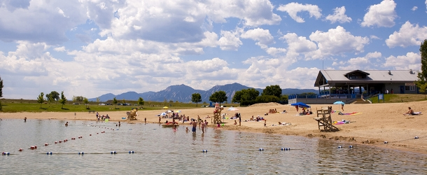 People play at the beach at Boulder Reservoir
