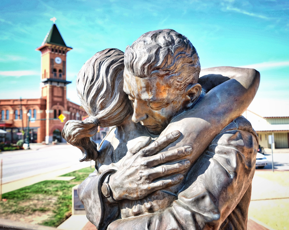"""""""Coming Home"""" is a two-piece sculpture which depicts a soldier returning from service to a loving embrace."""