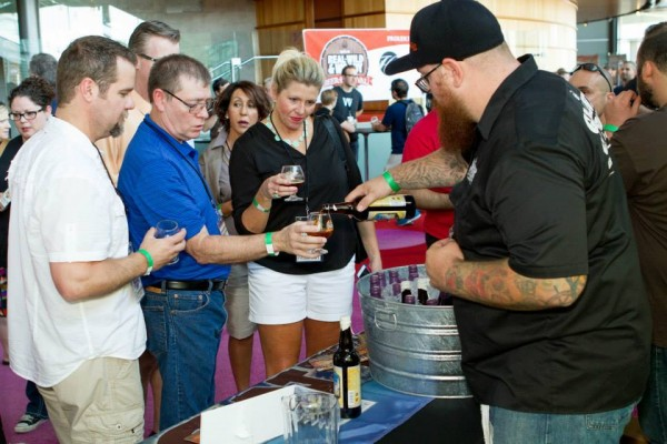 Attendees sample a craft brew at Real Wild and Woody Beer Festival
