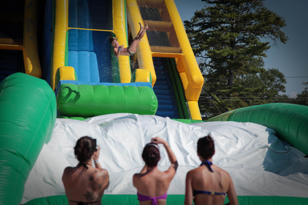 Catching some air on the Drop Kick water slide during Slide Across America