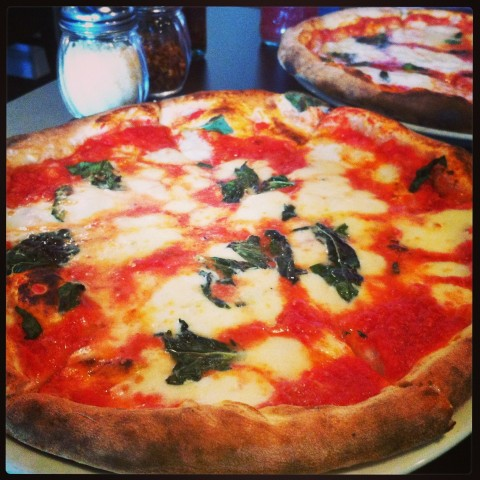 The Margherita (front) and Bufala at Pomo Pizzeria
