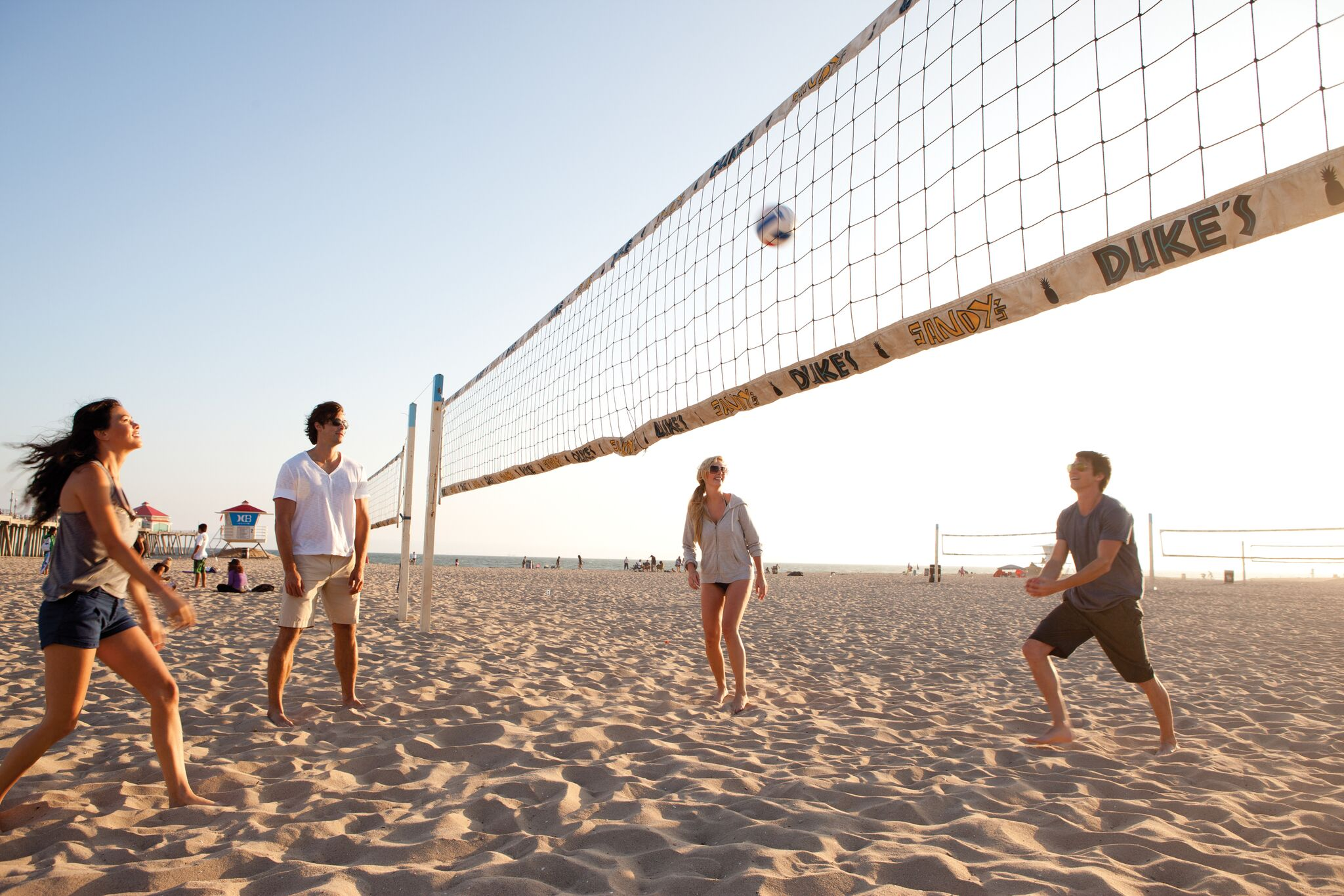 Why do women beach volleyball players wear bikinis while men wear shorts and tank tops?