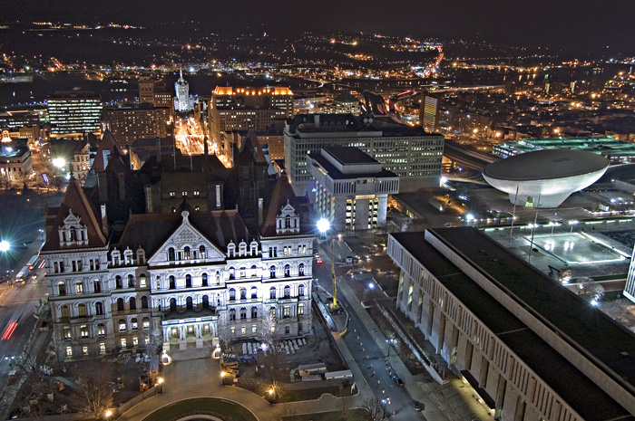 aerial photo of Albany, Capital and plaza buildings at night