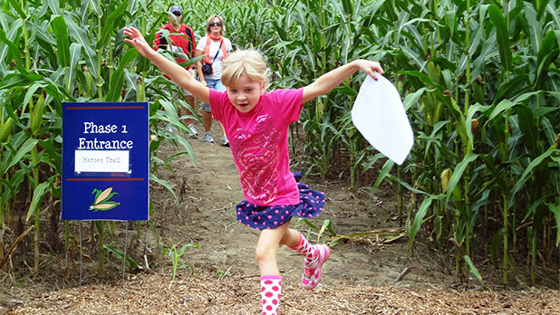 Girl leaping in maze - Photo by Fort Ticonderoga