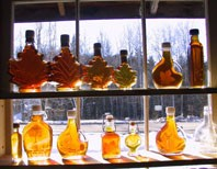 Maple syrup bottles in the window at Uihlein Maple Forest, Lake Placid