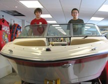 Adam (right) and Jacob Cooper will begin earning their Young Boater Safety Certificates at the February 10-14, 2010 Central New York Boat Show. The training is being offered for hearing and, for the first time at the show, for deaf youth.