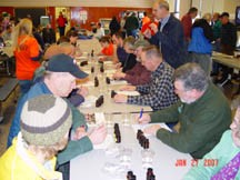 An always popular St. Lawrence County Maple Expo workshop helps producers compare maple flavors affected by different production factors. Participants enjoy taste testing as they learn. Photo: Steve VanderMark, CCE St. Lawrence County