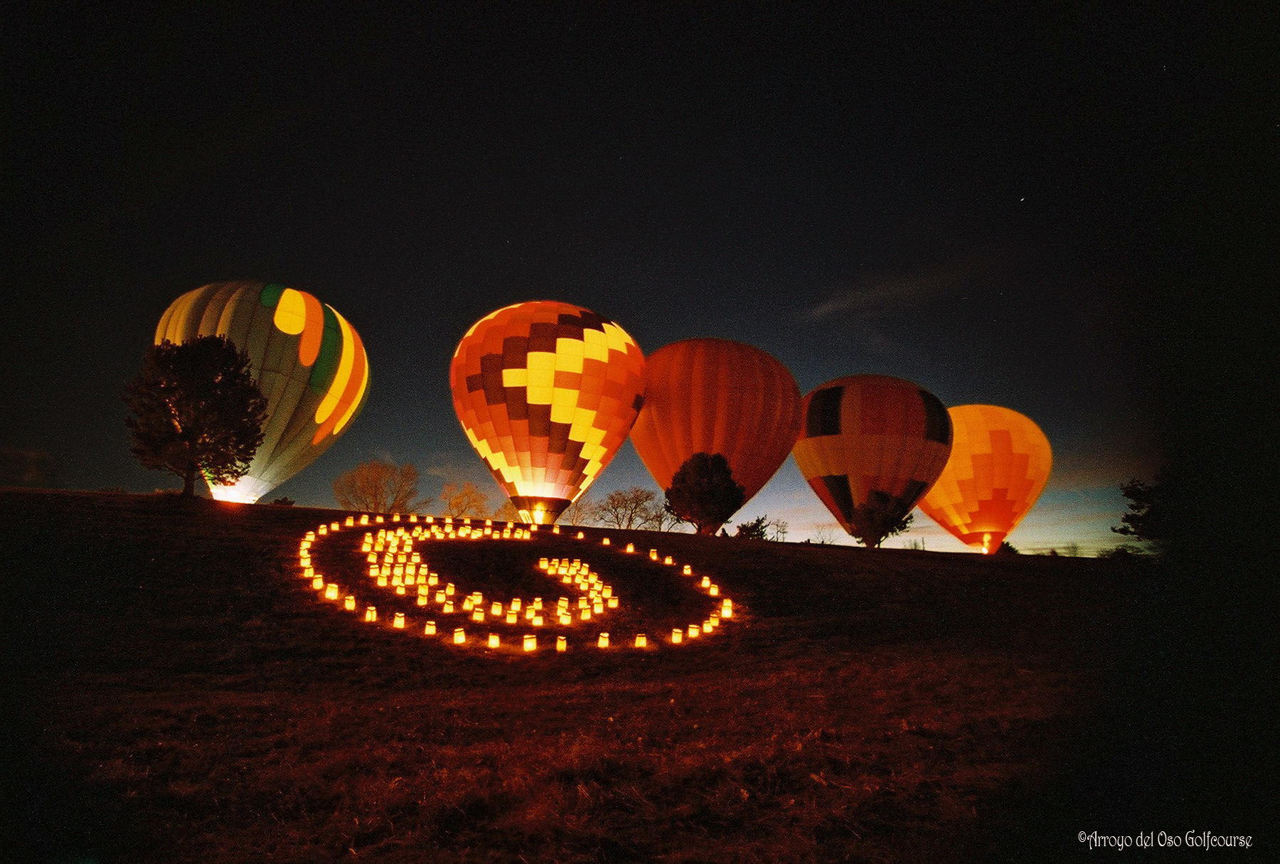 Arroyo del Oso Balloon Glow on Christmas Eve in Albuquerque