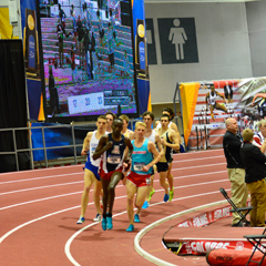 Athletes compete at the indoor track and field facility in the Albuquerque Convention Center