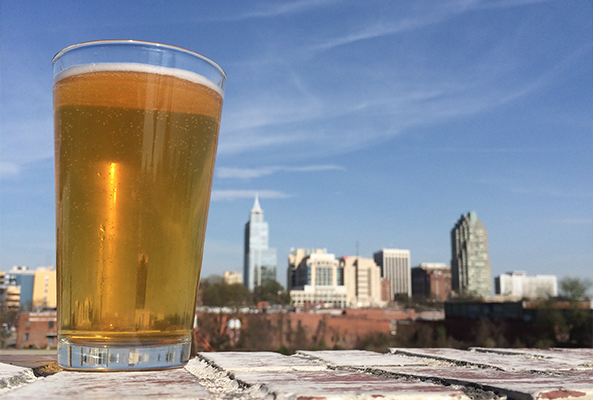 Downtown Raleigh skyline with brew
