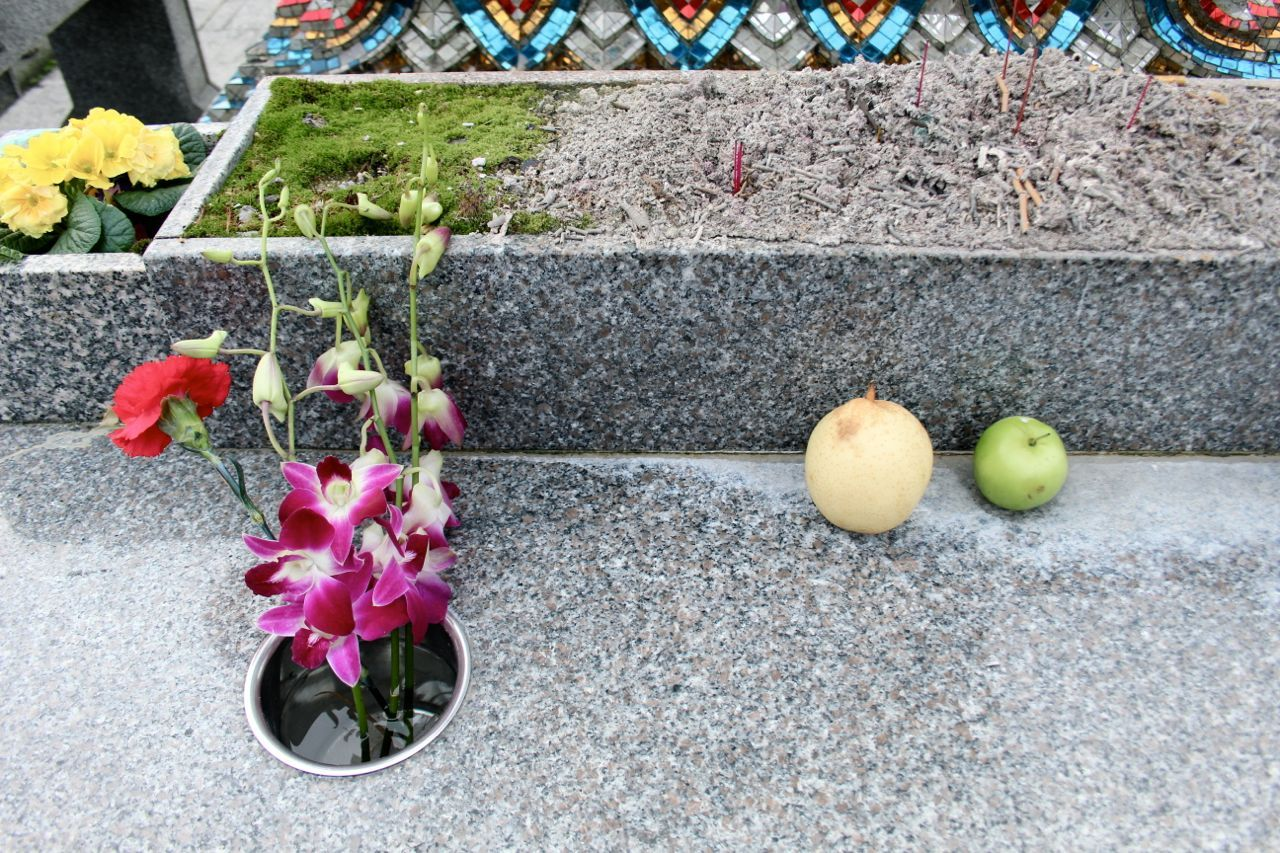 fruit and flowers at Buddhist shrine