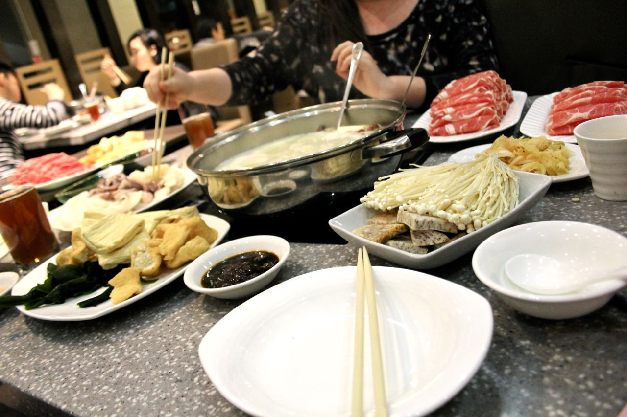 table full of food for hot pot