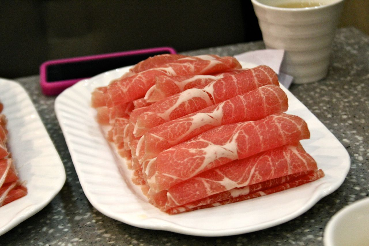slices of pork at Mongolian hot pot
