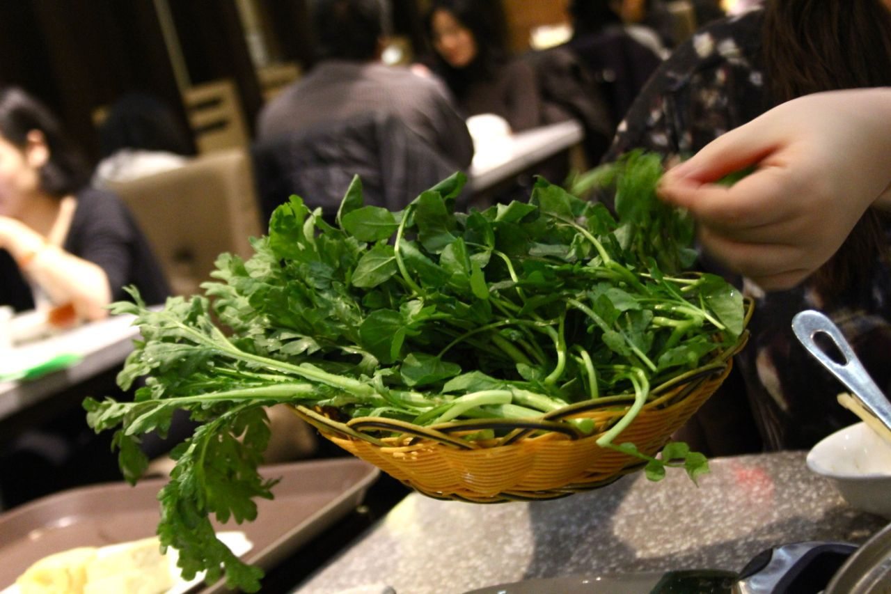 basket of Chinese greens for hot pot