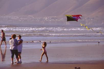 Flying a Kite on the beach in Pismo Beach California