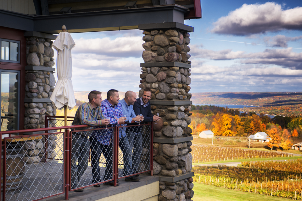 Guys Enjoying Wine in Autumn Overlooking Vineyard courtesy of Stu Gallagher