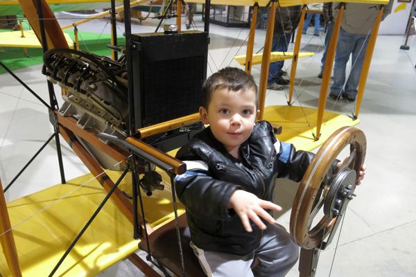Baby J tries steering a plane
