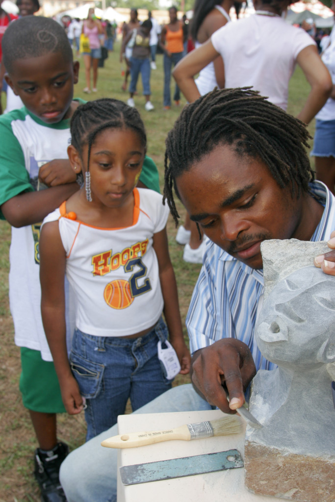Alabama, Huntsville, Black Arts Festival, stone sculptor Stalin Tafura, boy, girl, watch,