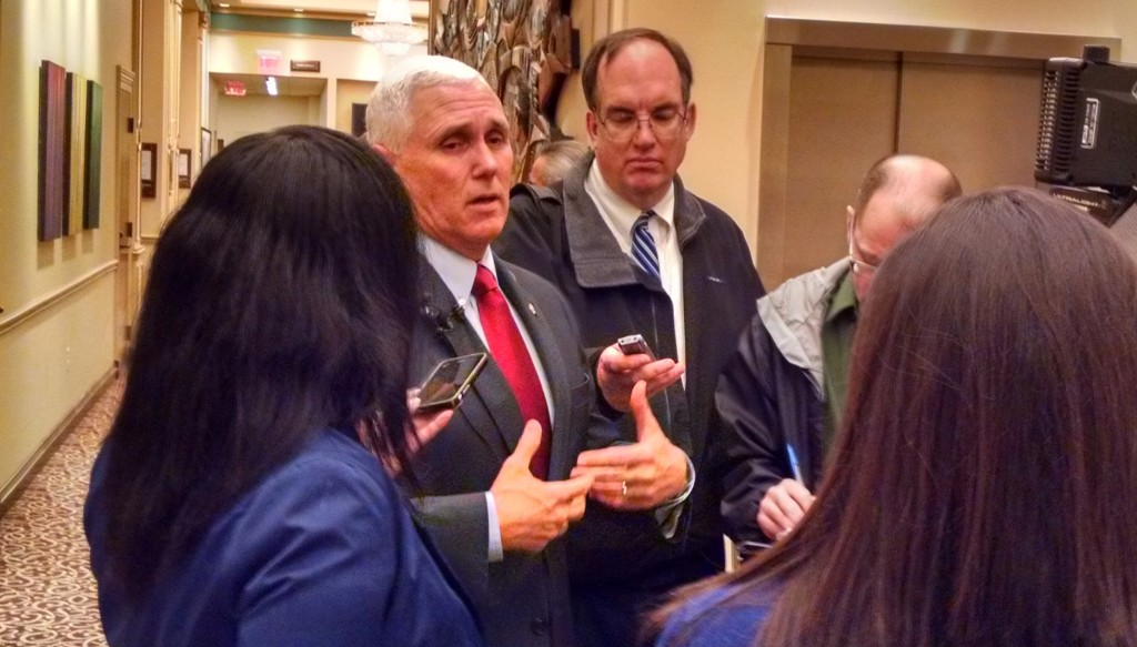 Indiana Gov. Mike Pence (second from left) speaks to reporters at the Lerner Theatre on Tuesday, Dec. 22, 2015. Pence and other state and regional leaders celebrated Regional Cities of Northern Indiana's grant for economic development projects.