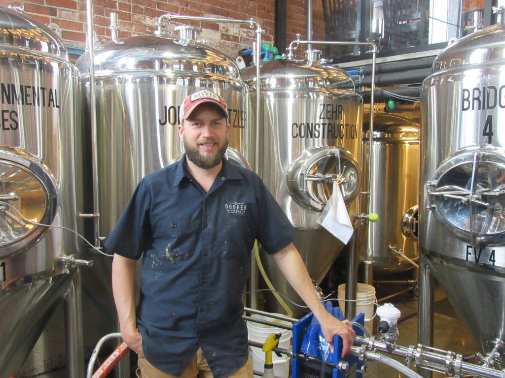 Jesse Sensenig attends to the brewhouse at Goshen Brewing Co.