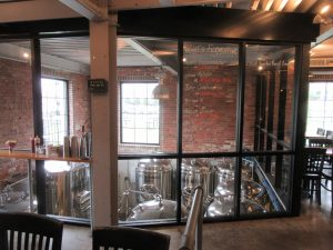 A view into the brewhouse from the dining area at Goshen Brewing Co.