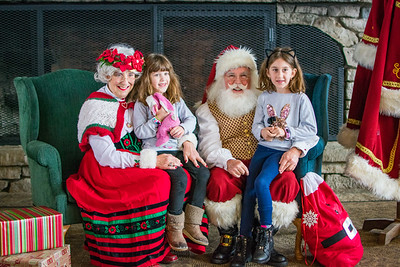 Two girls visit with Mrs. Claus and Santa