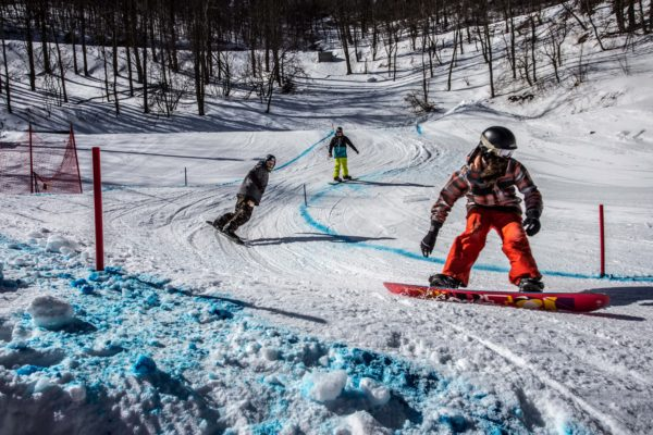 young skiers race at App Ski Mtn