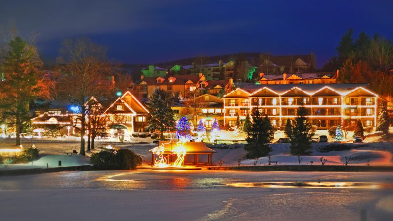 Christmas light forms surround the lake and manor at Chetola Resort