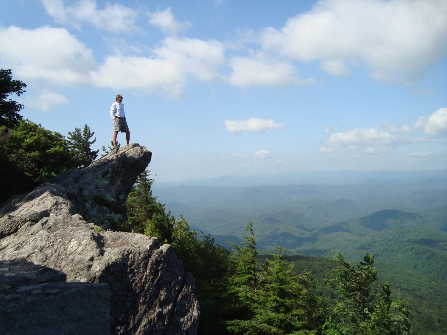 A man stands on The Blowing Rock overlooking Johns River Gorge