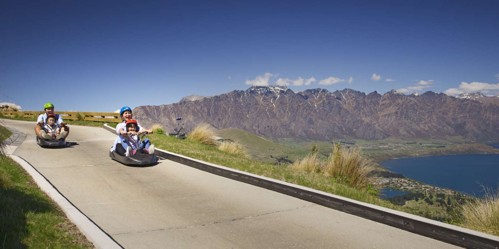 Family on a luge ride at Skyline Goldola Queenstown