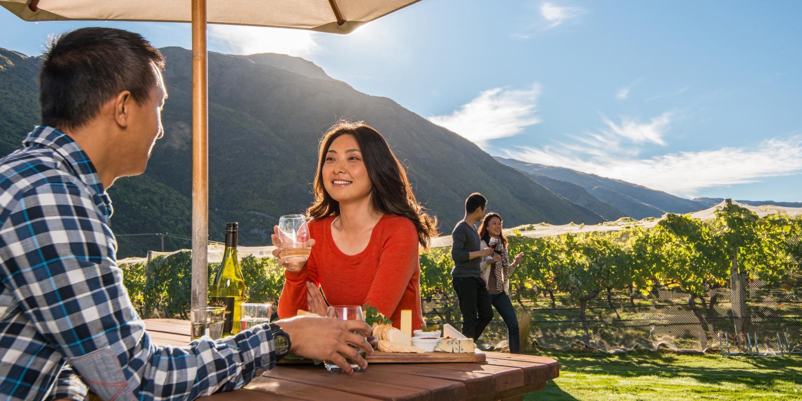 Wine tasting by vineyard in Gibbston Valley