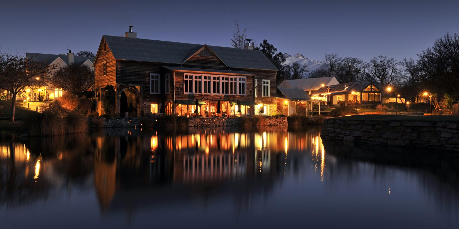 The Millhouse Restaurant at Millbrook lit up at night