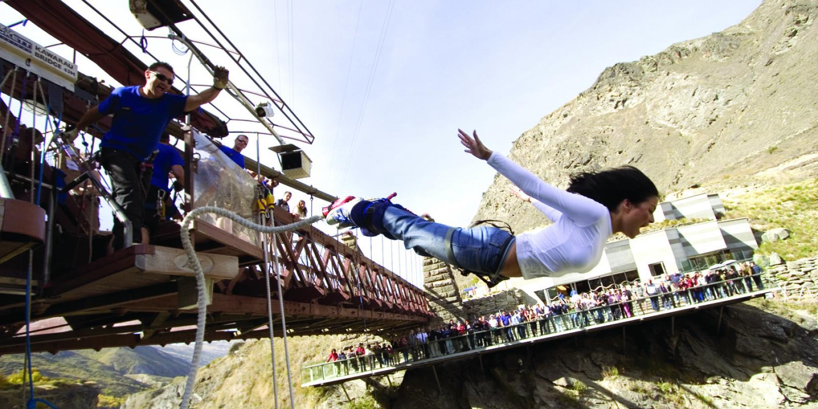 Woman jumping off the AJ Hackett Kawarau Bungy Bridge