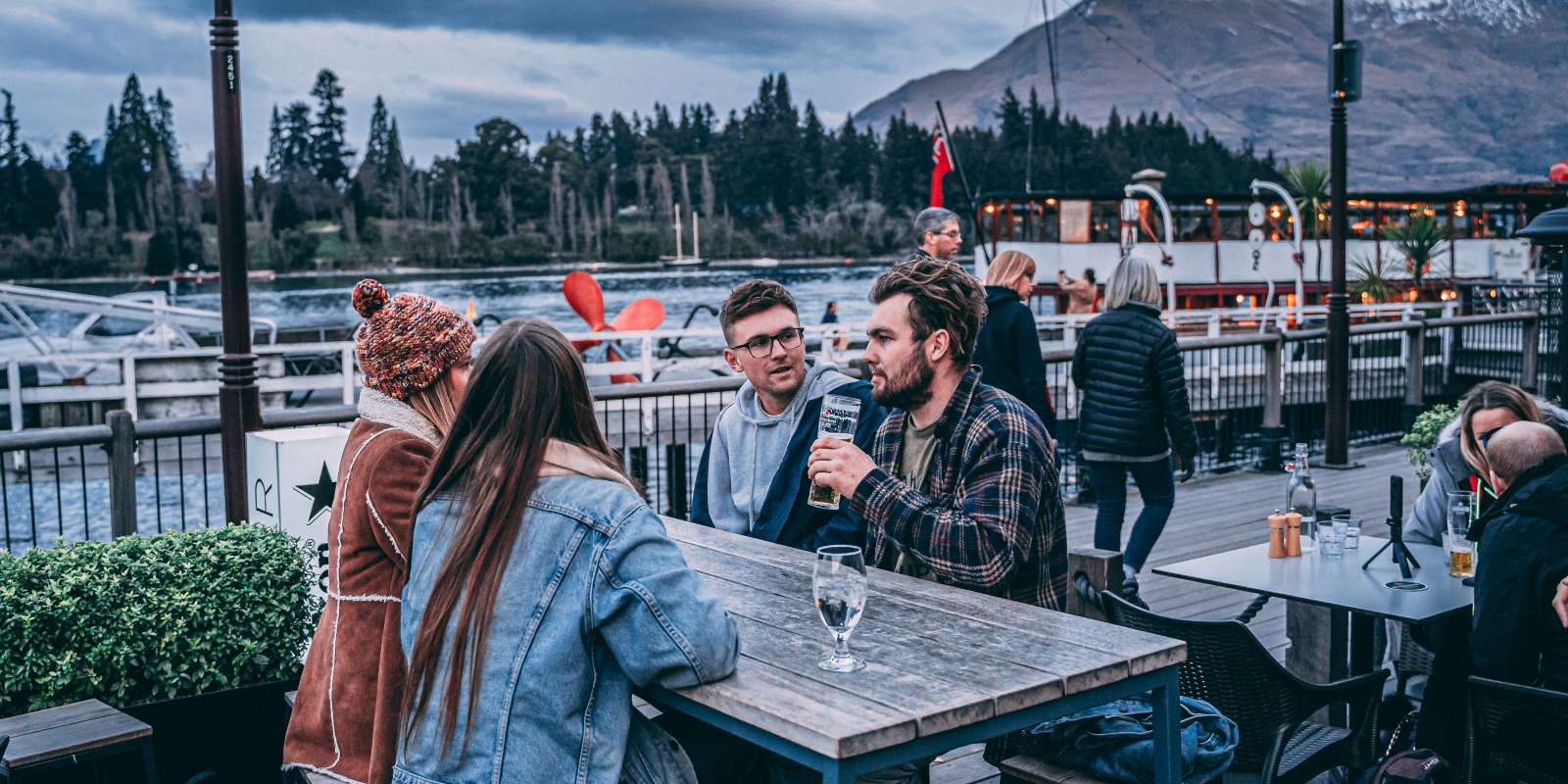 Après ski with friends on Steamer Wharf, Queenstown
