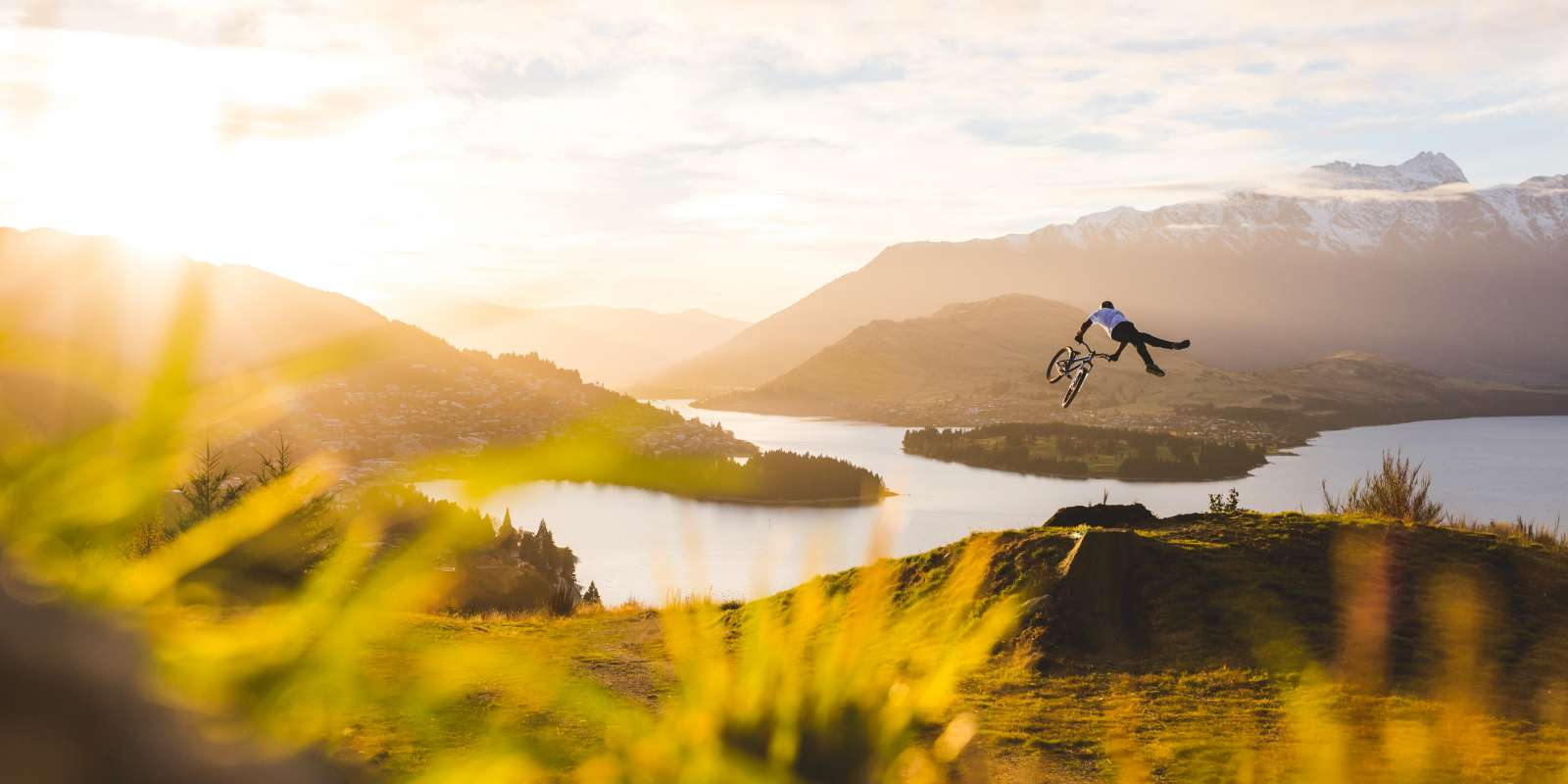 Mountain Biker Jumping in Queenstown New-Zealand